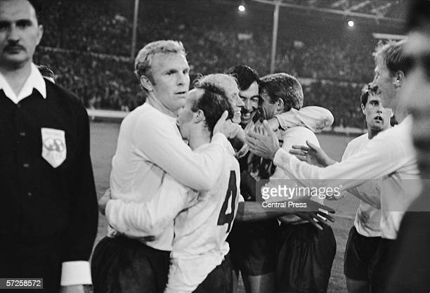 Captain Bobby Moore celebrating with his England team mates after their 21 victory over Portugal in the 1966 World Cup semi final at Wembley 27th...