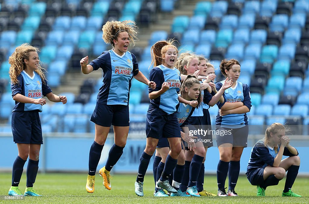 Captain, Brenna McPartlan of St Bede's School (2ndL) and team celebrates the win after a penalty shoot out during the Premier League U16 Schools Cup For Girls final between St Bede's School and Kings' School at the Etihad Campus on May 06, 2016 in Manchester, England.
