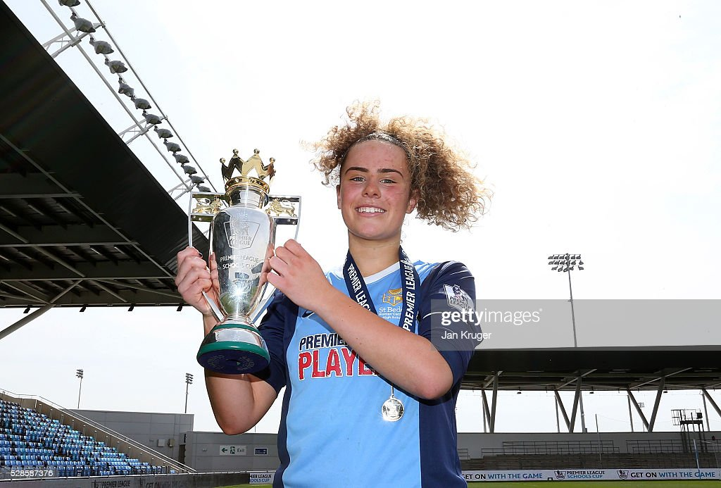 Captain, Brenna McPartlan of St Bede's School celebrates with the trophy during the Premier League U16 Schools Cup For Girls final between St Bede's School and Kings' School at the Etihad Campus on May 06, 2016 in Manchester, England.