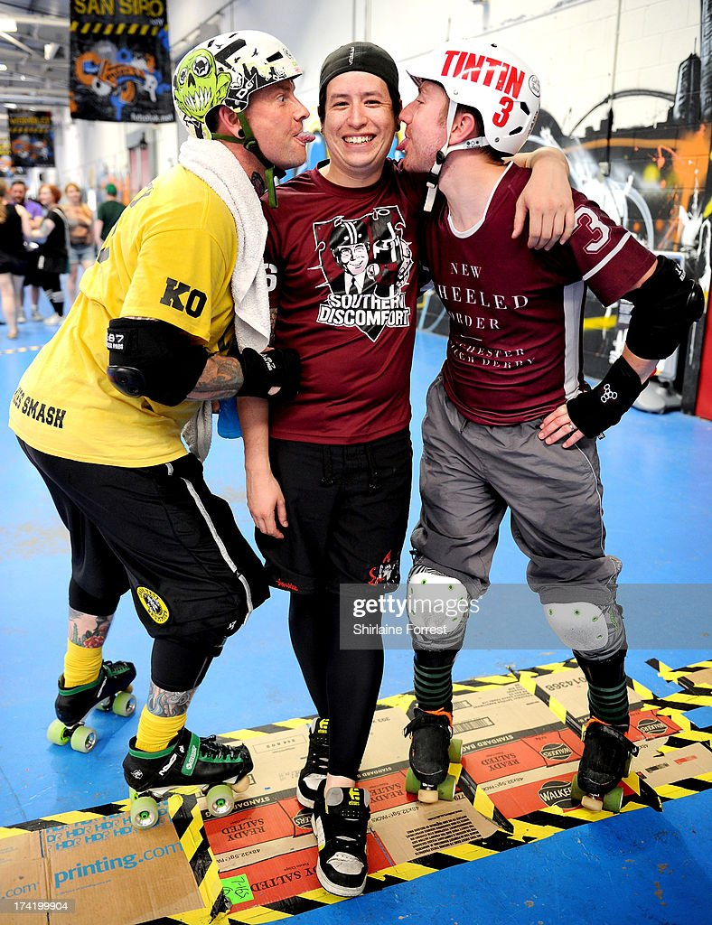 Captain Cageman of Crash Test Brummies (L) and Tintin of New Wheeled Order (R) lick Gwai-Lo of Southern Discomfort (C) at the Mens European Roller Derby Championships at Futsal on July 21, 2013 in Birmingham, England.