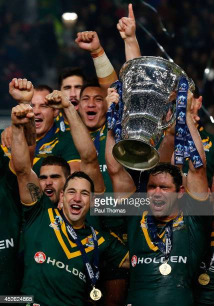 Captain Cameron Smith and Billy Slater of Australia celebrate with the trophy after the Rugby League World Cup final between New Zealand and...