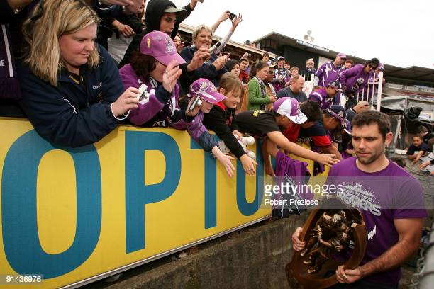 Captain Cameron Smith of the Storm arrives with the NRL Premiership trophy during the Melbourne Storm NRL Grand Final Reception at Visy Park on...