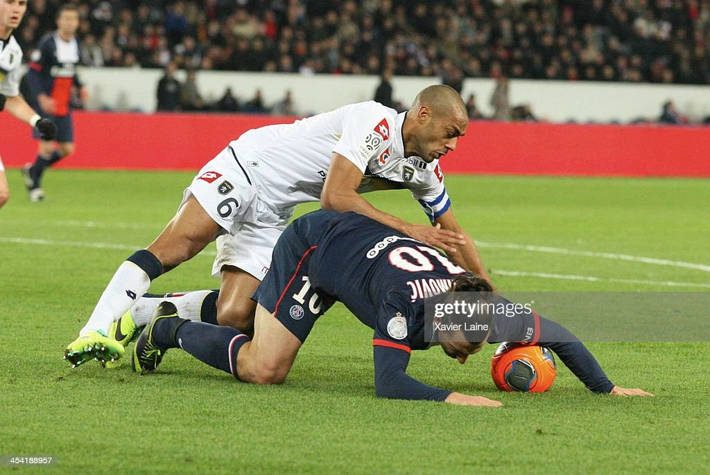 Captain <a gi-track='captionPersonalityLinkClicked' href=/galleries/search?phrase=Cedric+Kante&family=editorial&specificpeople=648441 ng-click='$event.stopPropagation()'>Cedric Kante</a> of Sochaux Montbeliard and <a gi-track='captionPersonalityLinkClicked' href=/galleries/search?phrase=Zlatan+Ibrahimovic&family=editorial&specificpeople=206139 ng-click='$event.stopPropagation()'>Zlatan Ibrahimovic</a> of Paris Saint-Germain during the French Ligue 1 between Paris Saint-Germain FC and Sochaux-Montbeliard FC at Parc Des Princes on december 7, 2013 in Paris, France.