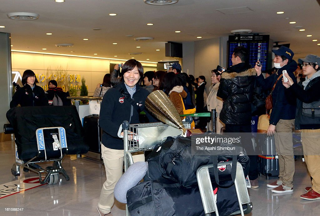 Captain Chiho Osawa (C) and other members of Japan Women's Ice Hockey team are seen upon arrival at Narita International Airport on February 12, 2013 in Narita, Chiba, Japan. Japan Women's Ice Hockey team qualified for Sochi Olympic.
