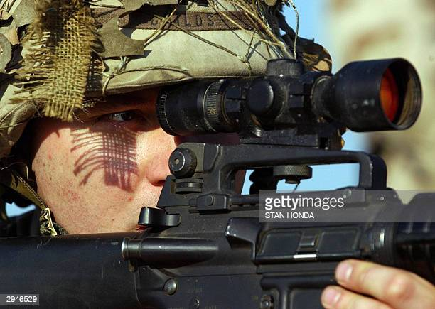 Captain Childs from the 122 Batallion of the 4th Infantry Division watches two men in a boat through the scope on his rifle on the Tigris river 08...