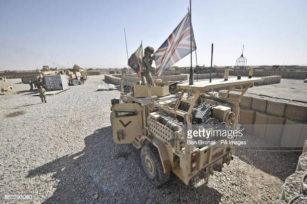 Captain Chris Hallam 1st Regiment Royal Horse Artilliary makes final checks and straightens out the Union Flag aboard his Husky vehicle as he...