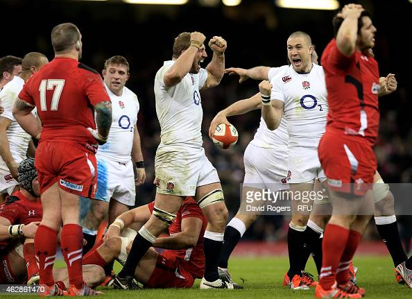 Captain Chris Robshaw of England and Mike Brown of England celebrate their team's 2116 victory as the final whistle blows during the RBS Six Nations...