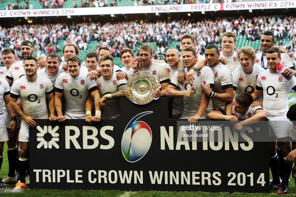 Captain Chris Robshaw of England celebrates alongside team mates with the Triple Crown trophy after victory in the RBS Six Nations match between...