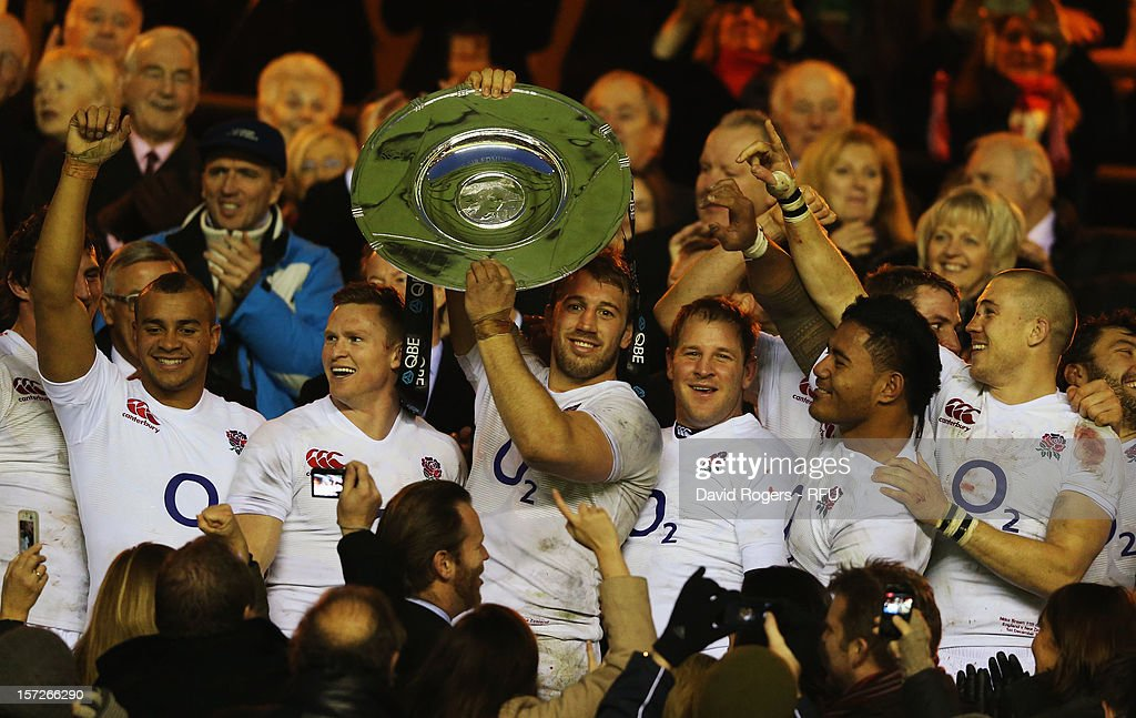 Captain <a gi-track='captionPersonalityLinkClicked' href=/galleries/search?phrase=Chris+Robshaw&family=editorial&specificpeople=2375303 ng-click='$event.stopPropagation()'>Chris Robshaw</a> of England lifts the Sir Edmund Hillary Shield during the QBE International match between England and New Zealand at Twickenham Stadium on December 1, 2012 in London, England.