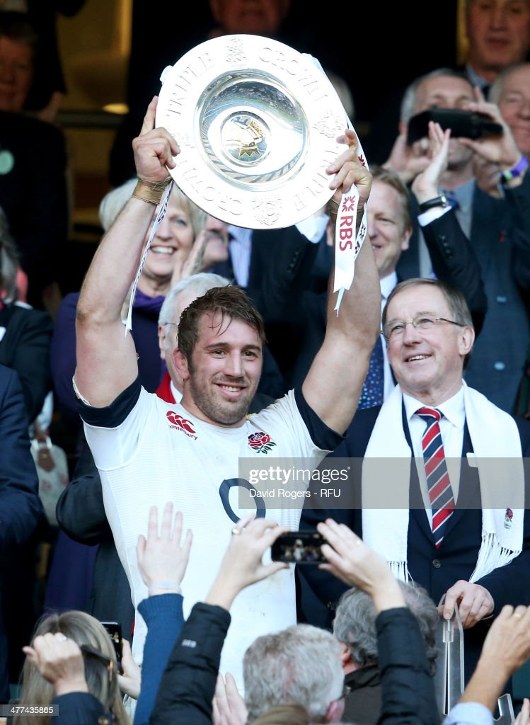 Captain <a gi-track='captionPersonalityLinkClicked' href=/galleries/search?phrase=Chris+Robshaw&family=editorial&specificpeople=2375303 ng-click='$event.stopPropagation()'>Chris Robshaw</a> of England lifts the Triple Crown trophy after victory in the RBS Six Nations match between England and Wales at Twickenham Stadium on March 9, 2014 in London, England.
