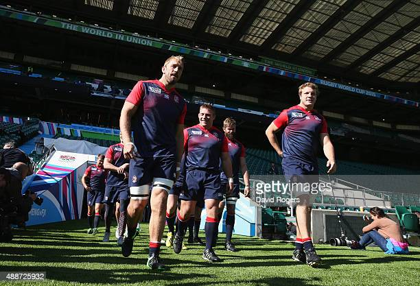 Captain Chris Robshaw walks out of the tunnel with team mates Tom Youngs Geoff Parling and Joe Launchbury during the England Captain's Run on the eve...