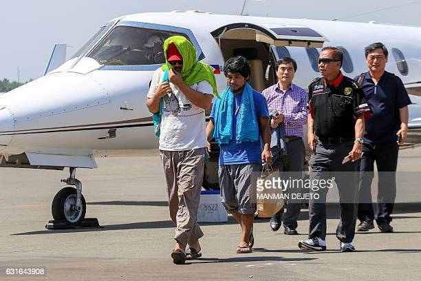 Captain Chul Hong Park a South Korean national and 2nd officer Filipino Glenn Alindajao two hostages released in Jolo Sulu arrive in Davao City with...