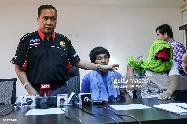Captain Chul Hong Park a South Korean national and 2nd officer Filipino Glenn Alindajao two hostages released in Jolo Sulu are presented to members...