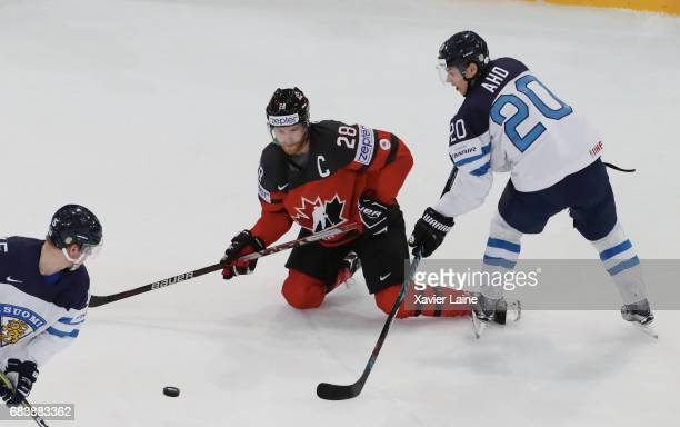 Captain Claude Giroux of Canada in action with Sebastian Aho of Finland during the 2017 IIHF Ice Hockey World Championship game between Canada and...