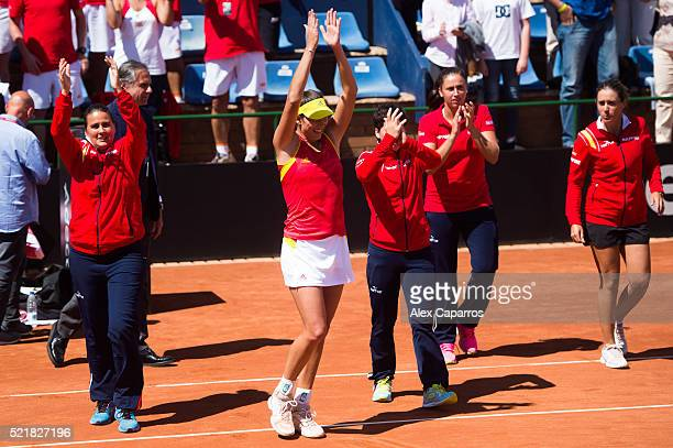 Captain Conchita Martinez Garbine Muguruza Carla Suarez Navarro Sara Sorribes and Anabel Medina of Spain celebrate defeating Italy during day two of...