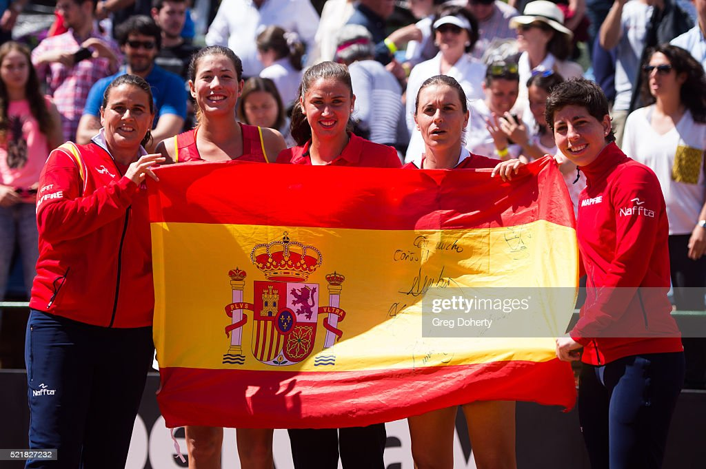 Captain <a gi-track='captionPersonalityLinkClicked' href=/galleries/search?phrase=Conchita+Martinez&family=editorial&specificpeople=184563 ng-click='$event.stopPropagation()'>Conchita Martinez</a>, Garbine Muguruza, Sara Sorribes, Anabel Medina and <a gi-track='captionPersonalityLinkClicked' href=/galleries/search?phrase=Carla+Suarez+Navarro&family=editorial&specificpeople=5294252 ng-click='$event.stopPropagation()'>Carla Suarez Navarro</a> of Spain celebrate defeating Italy during day two of the Fed Cup World Group Play-off Round match between Spain and Italy on April 17, 2016 in Lleida, Spain.