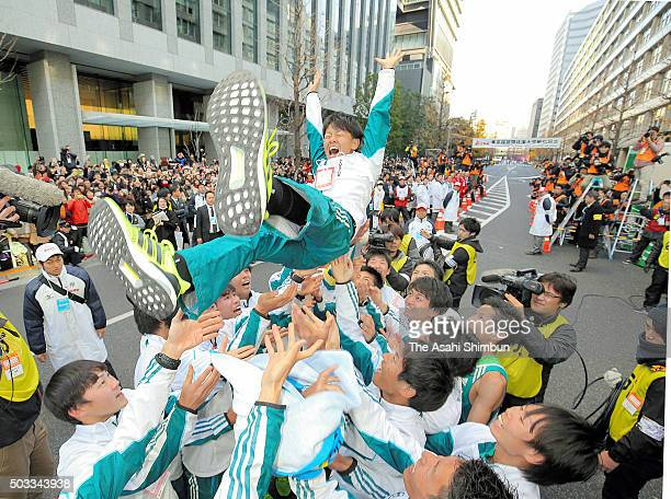 Captain Daichi Kamino of Aoyama Gakuin University is thrown into the air after winning the 92nd Hakone Ekiden on January 3 2016 in Tokyo Japan