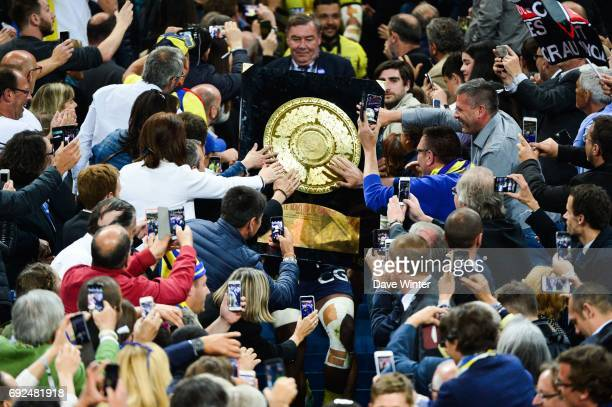 Captain Damien Chouly of Clermont brings the Bouclier de Brennus trophy down from the stand after the Top 14 Final between RC Toulon and Clermont...
