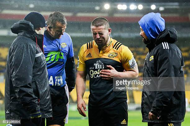Captain Dane Coles of the Hurricanes leaves the field with an injury during the Super Rugby Quarterfinal match between the Hurricanes and the Sharks...