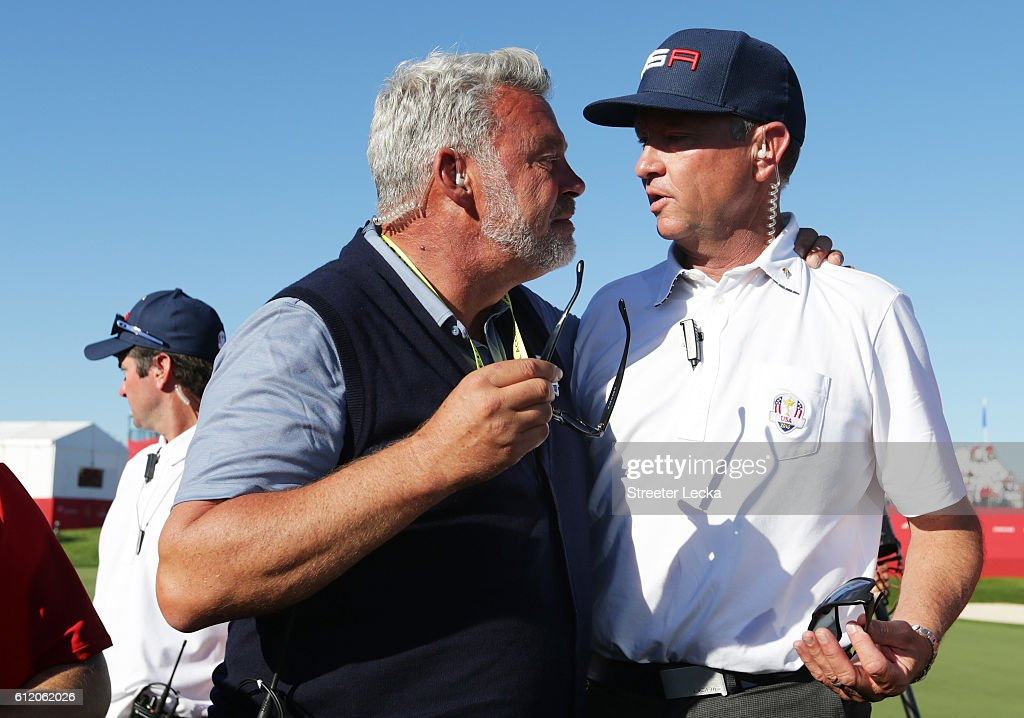 Captain Darren Clarke of Europe and captain Davis Love III of the United States react after the United States defeated Europe during singles matches of the 2016 Ryder Cup at Hazeltine National Golf Club on October 2, 2016 in Chaska, Minnesota.