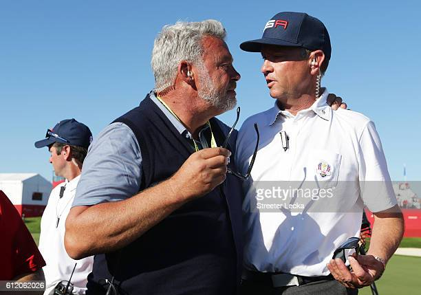 Captain Darren Clarke of Europe and captain Davis Love III of the United States react after the United States defeated Europe during singles matches...