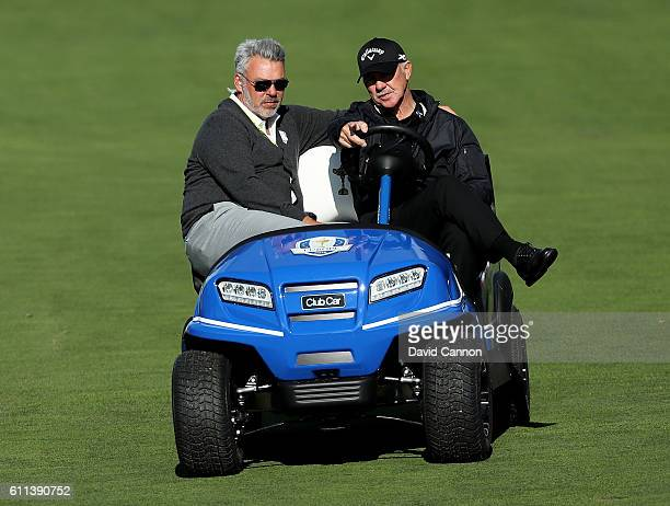Captain Darren Clarke of Europe rides in a cart with coach Pete Cowen during practice prior to the 2016 Ryder Cup at Hazeltine National Golf Club on...