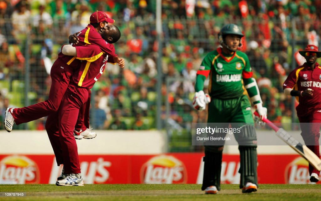 Captain <a gi-track='captionPersonalityLinkClicked' href=/galleries/search?phrase=Darren+Sammy&family=editorial&specificpeople=2920912 ng-click='$event.stopPropagation()'>Darren Sammy</a> of West Indies celebrates the wicket of <a gi-track='captionPersonalityLinkClicked' href=/galleries/search?phrase=Mushfiqur+Rahim&family=editorial&specificpeople=835117 ng-click='$event.stopPropagation()'>Mushfiqur Rahim</a> of Bangladesh during the 2011 ICC World Cup Group B match between Bangladesh and West Indies at Shere-e-Bangla National Stadium, Mirpur on March 4, 2011 in Dhaka, Bangladesh.