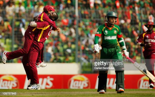 Captain Darren Sammy of West Indies celebrates the wicket of Mushfiqur Rahim of Bangladesh during the 2011 ICC World Cup Group B match between...