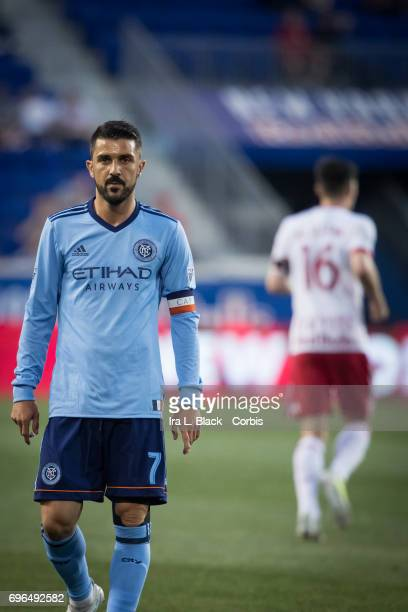 Captain David Villa of New York City FC walks away during a break in the action against the New York Red Bulls is in the background during the 2017...