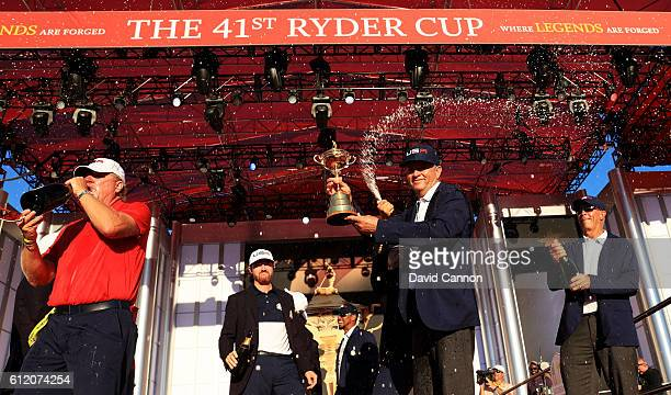 Captain Davis Love III of the United States celebrates during the closing ceremony of the 2016 Ryder Cup at Hazeltine National Golf Club on October 2...