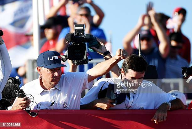 Captain Davis Love III of the United States celebrates with vicecaptain Bubba Watson after winning the Ryder Cup during singles matches of the 2016...