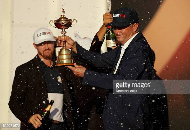 Captain Davis Love III of the United States holds the Ryder Cup at the colsing ceremonies after defeating Europe during singles matches of the 2016...