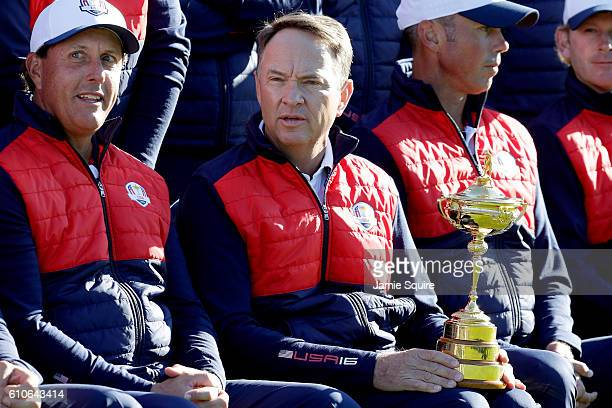 Captain Davis Love III of the United States holds the Ryder Cup during team photocalls prior to the 2016 Ryder Cup at Hazeltine National Golf Club on...
