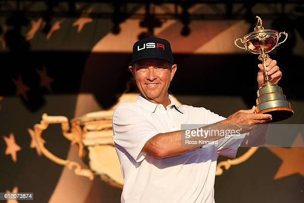Captain Davis Love III of the United States holds the Ryder Cup during the closing ceremony of the 2016 Ryder Cup at Hazeltine National Golf Club on...