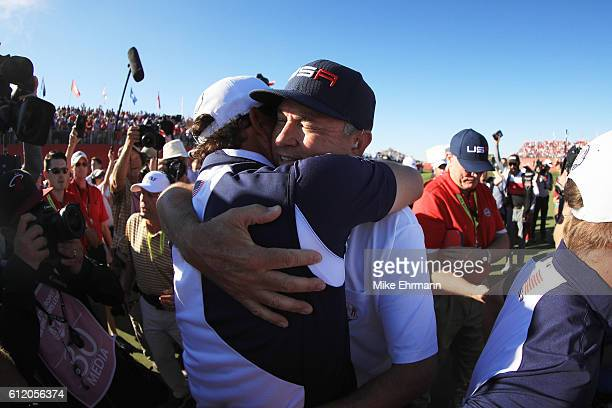 Captain Davis Love III of the United States reacts on the 18th green after winning the Ryder Cup during singles matches of the 2016 Ryder Cup at...