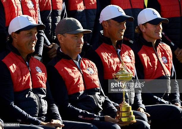 Captain Davis Love III Phil Mickelson Matt Kuchar and Brandt Snedeker pose during team photocalls prior to the 2016 Ryder Cup at Hazeltine National...
