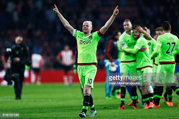 Captain Davy Klaassen of Ajax leads the team celebrations after victory in the Eredivisie match between PSV Eindhoven and Ajax Amsterdam held at...