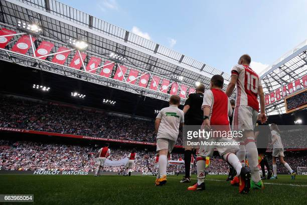 Captain Davy Klaassen of Ajax walks out to play the Dutch Eredivisie match between Ajax Amsterdam and Feyenoord at Amsterdam ArenA on April 2 2017 in...