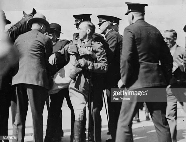 Captain de Groot being dragged from his horse by policemen after he had forestalled the official opening of Sydney Harbour Bridge by spurring his...