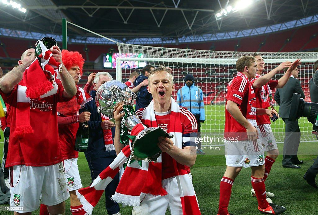 Captain Dean Keates of Wrexham celebrates with the trophy during the FA Trophy Final match between Wrexham and Grimsby Town at Wembley Stadium on March 24, 2013 in London, England.