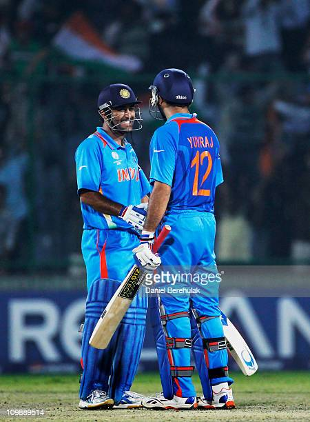 Captain MS Dhoni of India congratulates team mate Yuvraj Singh on scoring the winning runs during the 2011 ICC Cricket World Cup Group B match...