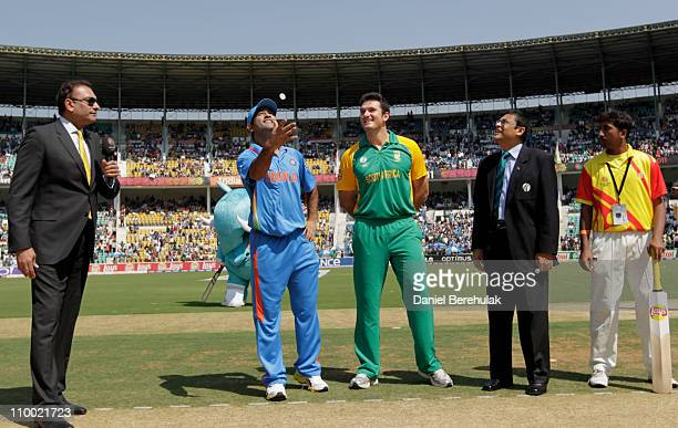 Captain MS Dhoni of India takes the coin toss as captain Graeme Smitth of South Africa looks on during the Group B ICC World Cup Cricket match...