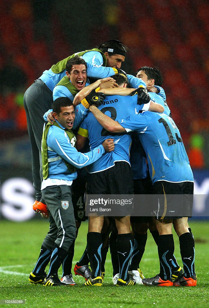 Captain <a gi-track='captionPersonalityLinkClicked' href=/galleries/search?phrase=Diego+Lugano&family=editorial&specificpeople=274735 ng-click='$event.stopPropagation()'>Diego Lugano</a> of Uruguay (C) celebrates victory with team mates following the 2010 FIFA World Cup South Africa Round of Sixteen match between Uruguay and South Korea at Nelson Mandela Bay Stadium on June 26, 2010 in Nelson Mandela Bay/Port Elizabeth, South Africa.