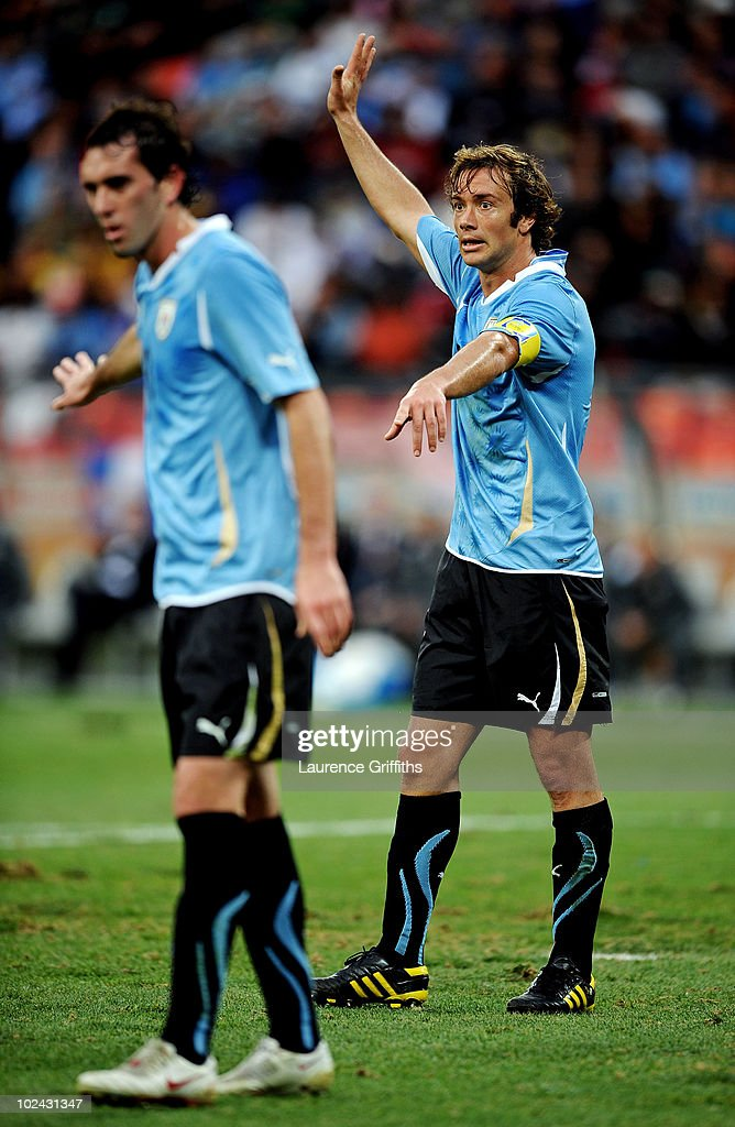 Captain Diego Lugano of Uruguay directs his team mates during the 2010 FIFA World Cup South Africa Round of Sixteen match between Uruguay and South...