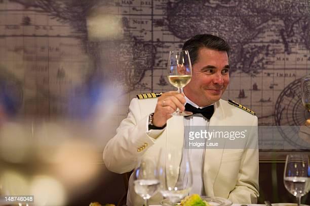 Captain Dimitriy Aksenov of cruiseship MS Astor (Transocean Kreuzfahrten) toasts guests at captain's table dinner during North Sea voyage.