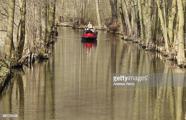 A captain directs his barge through a small canal on April 3 2010 in Lubbenau Germany The Spreewald touristic barge season opens yearly on the easter...