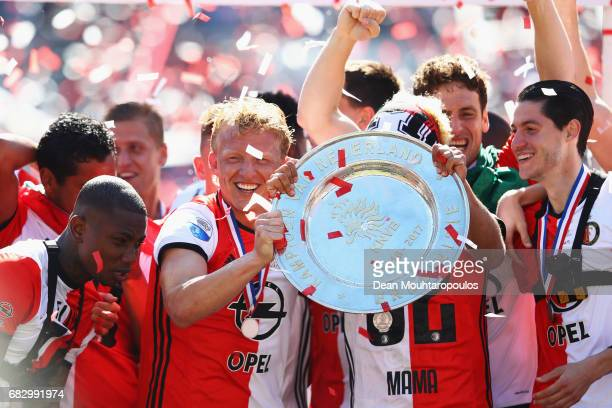 Captain Dirk Kuyt of Feyenoord Rotterdam celebrates in front of the home fans by lifting the trophy for winning the Dutch Eredivisie at De Kuip or...