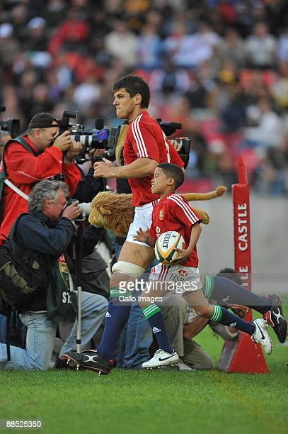 Captain Donncha O'Callaghan of the British and Irish Lions leads his team onto the field during the British and Irish Lions Tour match between...