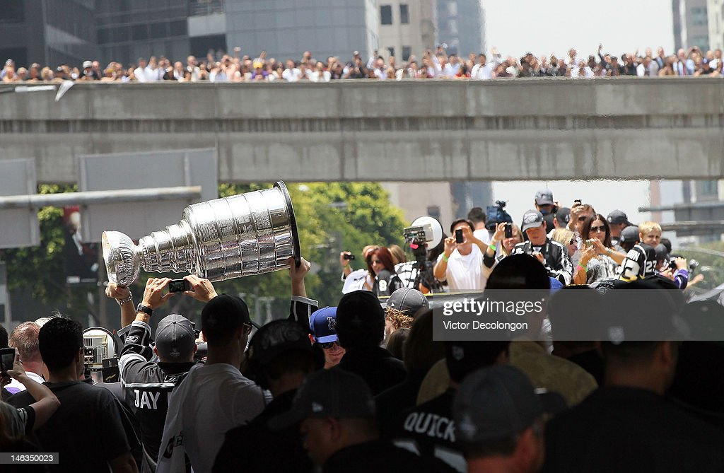 Captain Dustin Brown #23 of the Los Angeles Kings holds up the Stanley Cup to the fans during the Los Angeles Kings Stanley Cup Victory Parade on June 14, 2012 in Los Angeles, California.