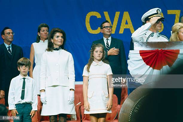 Captain Earl Yates commanding officer of the new carrier USS John F Kennedy salutes during the carrier's commissioning ceremonies Kennedy's widow...